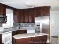 Remodeled kitchen with soft close cabinets, granite counters, gl